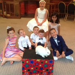 children with Snowy at a wedding event
